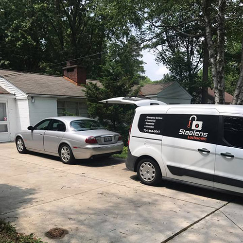 image of the Staelens locksmith van in a residential driveway with a Jaguar that the owner had lost the keys to.
